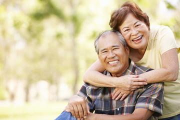 Portrait senior Asian couple in park