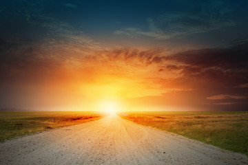Sunset above road