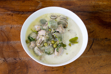 Thai Chicken Green Curry on old wooden background