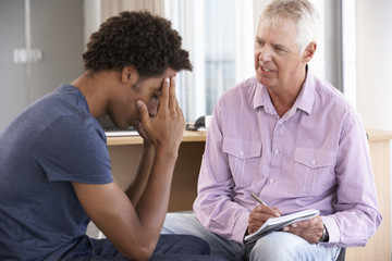 Young Man Having Counselling Session
