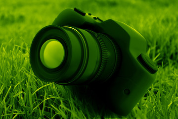 Dslr camera on green background