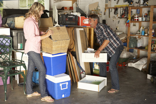 Couple Clearing Garage For Yard Sale