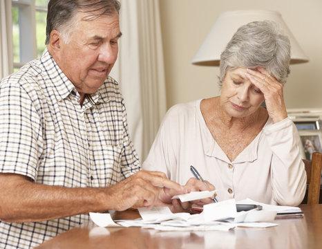 Senior Couple Concerned About Debt Going Through Bills Together