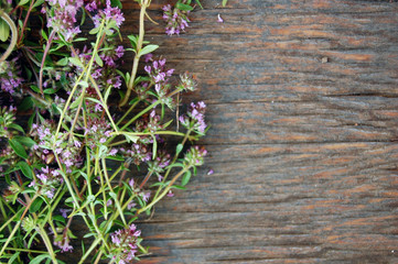 background of fresh thyme on wooden table