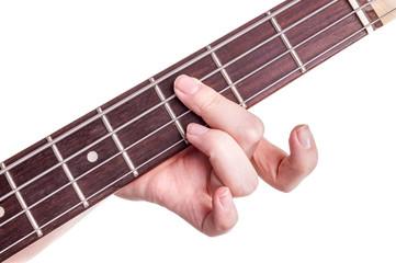 Hands of an teenager plays guitar