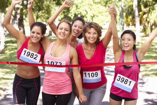 Group Of Female Athletes Completing  Charity Marathon Race