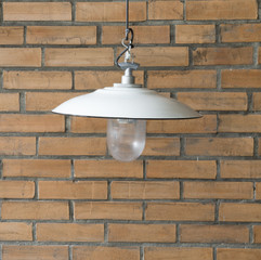 vintage white  lamp and red vintage brick wall -vintage tone