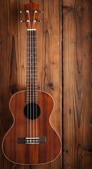 ukulele on wooden background