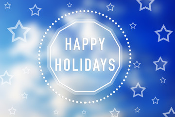 HAPPY HOLIDAYS written in the blue sky