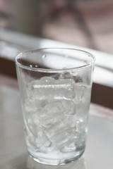 Glass of pure water with ice