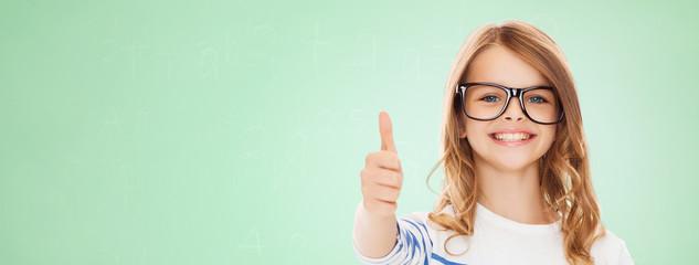 little girl with black eyeglasses