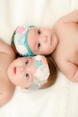 Two twin babies, girls in nice headbands