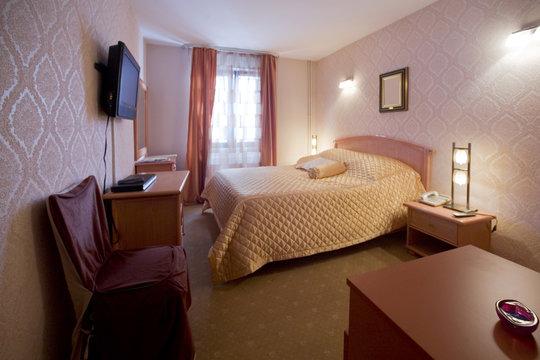 Pink hotel room interior