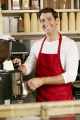 Man Making Coffee In Shop