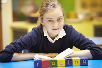"Word ""Learning"" Spelt In Wooden Blocks With Pupil Behind"