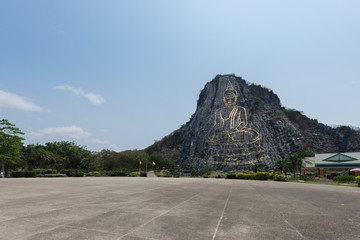 Carved buddha image on the cliff at Khao Chee
