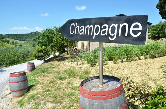 CHAMPAGNE arrow and wine barrels along rural road