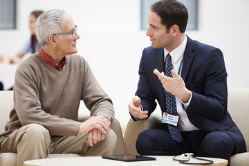Senior Man Discussing Test Results With Doctor