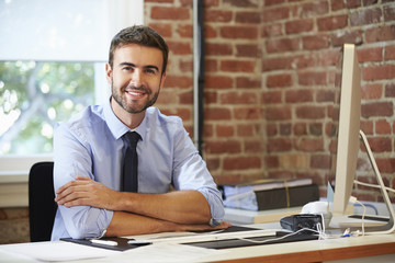 Man Working At Computer In Contemporary Office
