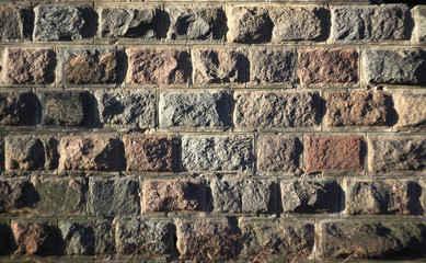 Old stone block wall of the bridge bearing