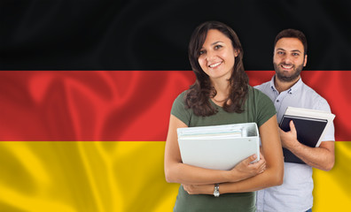 Couple of students over german flag