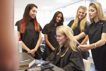 Teacher Helping Students Training To Become Hairdressers Wall mural