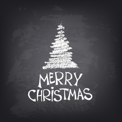 Hand drawn Merry Christmas text with stylized tree on blackboard