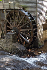 Old wooden grist mill water wheel