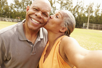 Romantic Senior Couple Taking Selfie In Park