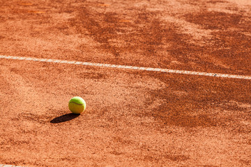 Tennis balls on the clay court.