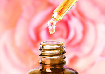Wall Mural - Aromatherapy, essential oil with pink rose background