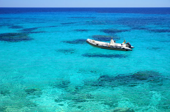 Crystal clear water with Boat