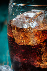 Glass of cola with ice. Close-up