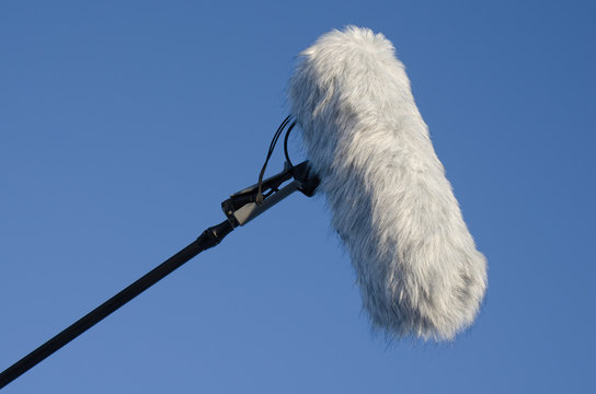 Microphone with windshield with blue sky background