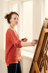 Beautiful woman artist drawing her picture