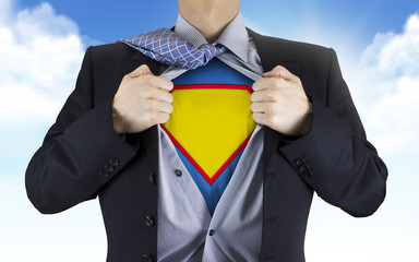 businessman showing superhero icon underneath his shirt