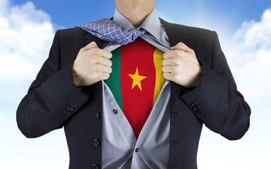 businessman showing Cameroon flag underneath his shirt