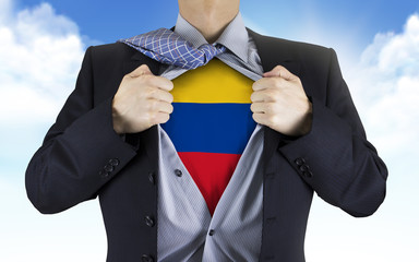 businessman showing Colombia flag underneath his shirt