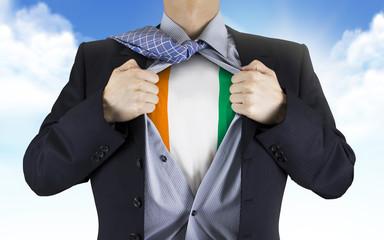 businessman showing Ivory Coast flag underneath his shirt
