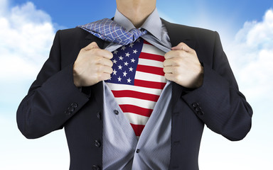businessman showing American flag underneath his shirt