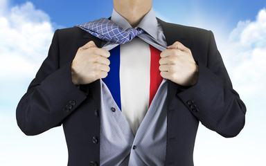 businessman showing France flag underneath his shirt