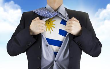 businessman showing Uruguay flag underneath his shirt