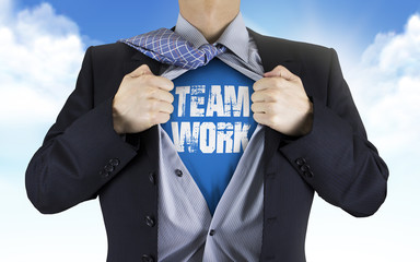 businessman showing Teamwork word underneath his shirt