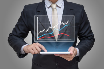 Businessman hand holding tablet graph finance on gray background