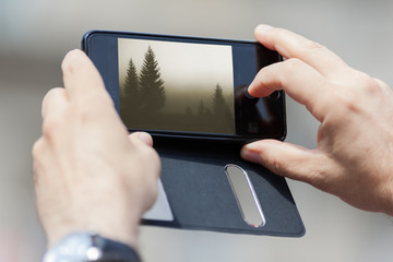 Closeup of photographing nature with smart phone