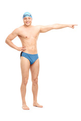 Young handsome swimmer pointing right with his hand