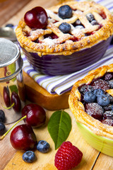 Decorated homemade shortcrust pastry berry pies