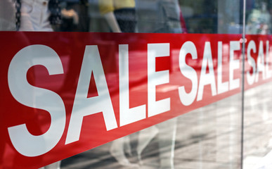 Sale sign on the window of the shopping mall