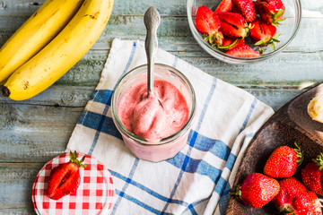 strawberry-banana ice cream in a glass fruit dessert, summer