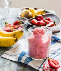 strawberry-banana ice cream in a glass fruit dessert, summer